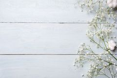 Free Spring Background. White Rustic Flowers On Blue Wooden Table. Banner Mockup For Womans Or Mother Day, Happy Easter, Spring Holiday Stock Photos - 140193413