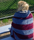 Spring Ball. Mom watching ball game in the cold spring Royalty Free Stock Image
