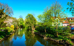 Spring on the banks of Kinzig River in Gelnhausen, the Kaiserpfalz, Hesse, Germany Stock Photo