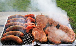 Spring barbecue. Meat and sausage barbecue outdoor Royalty Free Stock Photography