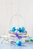 Spring basket Easter eggs blue tone Stock Images