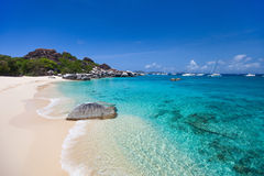 Spring bay at Virgin Gorda, BVI. Stunning beach with white sand, unique huge granite boulders, turquoise ocean water and blue sky at Virgin Gorda, British Virgin royalty free stock image
