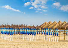 Spring beach. The warm sun of late spring on a deserted beach still waiting for the summer and tourists Royalty Free Stock Photography