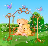 Spring bears. Two cute bears on seesaw in spring day Stock Images