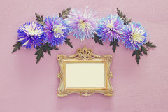 spring beautiful blue flowers and blank victorian photo frame Royalty Free Stock Photography