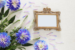 spring beautiful blue and white flowers and blank victorian photo frame Stock Photo
