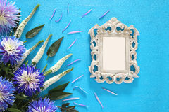 Spring beautiful blue and white flowers and blank victorian photo frame. Top view image of spring beautiful blue and white flowers and blank victorian photo royalty free stock photography