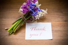 Spring beautiful flowers of a hyacinth with a thank you card stock photos