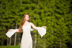 Spring - Beautiful romantic woman in sunny nature Stock Image