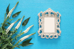 spring beautiful white flowers and blank victorian photo frame Royalty Free Stock Image