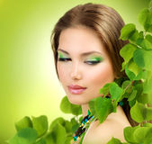 Spring Beauty. Beautiful Girl with Green Leaves. Spring Beauty outdoor Stock Image
