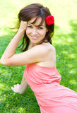 Spring Beauty Girl. Beautiful Young Woman Lying on Green Grass outdoor Royalty Free Stock Images