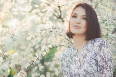 Spring beauty girl with blooming sakura tree. Royalty Free Stock Photo