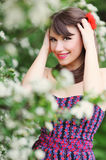 Spring beauty girl with long blonde hair outdoors. Blooming tree Royalty Free Stock Images