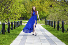 Spring beauty girl with long red blowing hair outdoors Royalty Free Stock Images