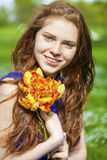 Spring beauty girl with long red blowing hair outdoors Royalty Free Stock Image
