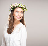 Spring beauty wearing flower wreath. Royalty Free Stock Photos