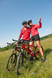 Spring bike - Young sportive couple in meadow Stock Photo