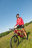 Spring bike - Young sportive woman in meadow Royalty Free Stock Photography