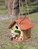 Spring birdhouse. Spring, the birds come to them build and hang on trees such birdhouses Royalty Free Stock Photography