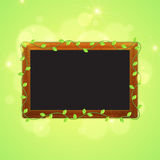 Spring blackboard with green leaves. Stock Images