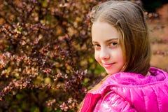 Spring bloom fragrance. Girl teen walk in botanical garden. Peaceful environment garden. Enjoying nature. Kid cute fancy. Child spend time in park. Explore stock photo