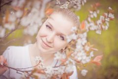 Spring blooming and girl Stock Image