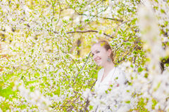 Spring blooming and girl Stock Photography