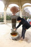 Spring Blooms in Karlovy Vary. Fulfilling the cup from Thermal Hot Spring in the 15th mineral spring of Karlovy Vary, known as The Snake's Spring (Hadi Pramen) Stock Image