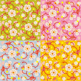 Spring blossom floral seamless repeat patterns. Four easy tilable spring blossom floral seamless repeat patterns (prints, wallpapers, backgrounds). Flat fresh stock illustration