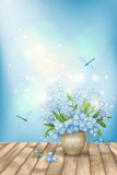 Spring blue flowers dragonflies on wood background Stock Photos