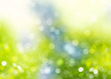 Spring blue green nature blurred background. Green blue glitter bokeh blurred background.Fresh spring natural wallpaper Stock Image