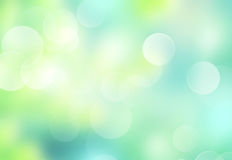 Spring blurred background.Green blue foliage wallpaper. Royalty Free Stock Images