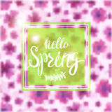 Spring Blurred Background whith Lettering and Flowers. Stock Photo