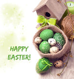 Spring border in green and brown with Easter eggs and spring dec. Orations on white, space for your text stock photo
