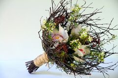 Spring bouquet on a frame from branches. Spring flowers and orchids Stock Image