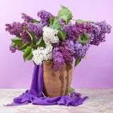 Spring bouquet. Lily of the valley and lilac in a vase Stock Images
