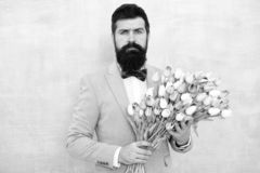 Spring bouquet. 8 of march. love date with flowers. Happy Birthday. bearded man in bow tie with tulip flowers. womens