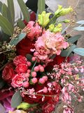 Spring bouquet of mixed colorful flowers. Flowers bouquet including pink genista, pink Eustoma, red rose, pink hypericum berries. Close-up Beautiful Bouquet royalty free stock images