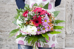 Spring bouquet. Modern spring bouquet in flowershop. Flower bouguet in pink color Royalty Free Stock Image