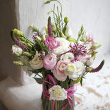 The Spring bouquet of pink Ranunculus, lisianthus and Veronica f