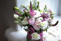 The Spring bouquet of pink Ranunculus, lisianthus and Veronica f Stock Image