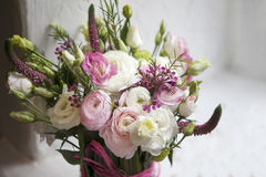 The Spring bouquet of pink Ranunculus, lisianthus and Veronica f Royalty Free Stock Photos
