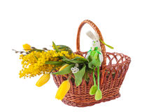 Spring bouquet and rabbit mass produced products on a white ba stock photos