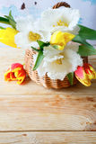 Spring bouquet of tulips in a basket Stock Images