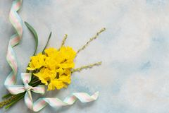 Spring bouquet with yellow narcissus on the blue sky background.  royalty free stock photography