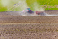 Spring sowing with tractor. And seeding machine Royalty Free Stock Image