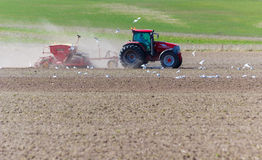 Spring sowing with tractor Stock Images