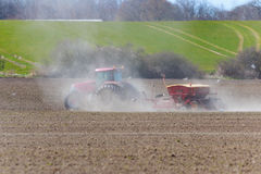 Spring sowing with tractor. And seeding machone on the field Royalty Free Stock Image