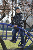 Spring boy playing on the playground. Stock Images